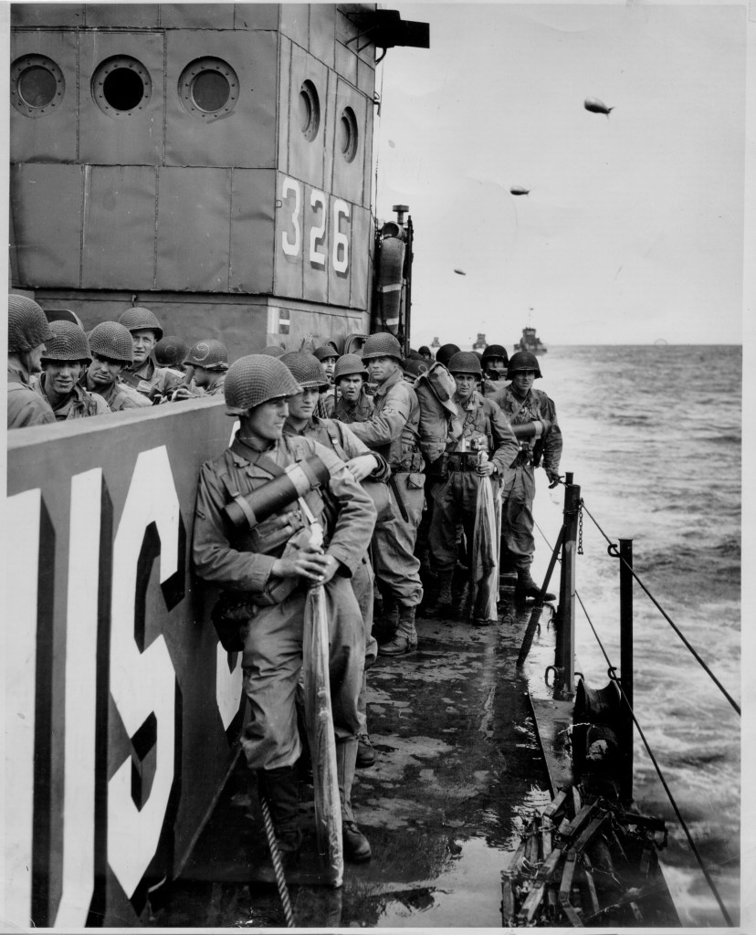 Image of a US Coast Guardsmen lined up on a ship wearing combat helmets. Come with me down the novel research hole. Learn about the U.S. Coast Guard(USCG).