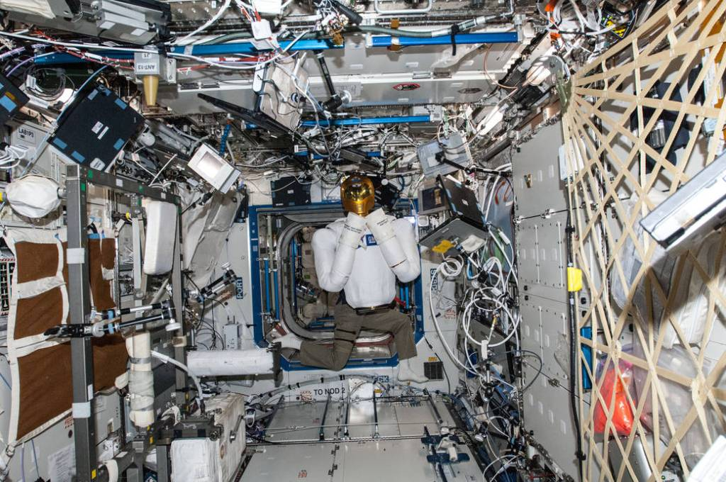 Image of Robonaut floating in the International Space Station.  Robots and A.I. will challenge our humanity.