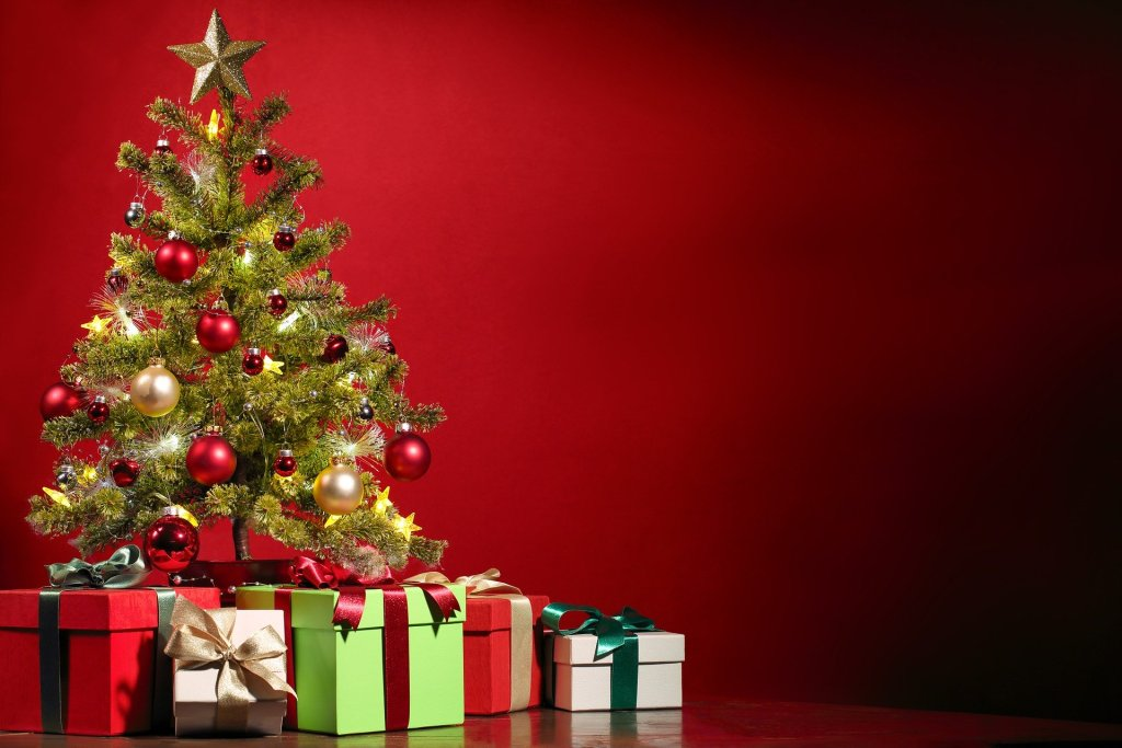 Image of a Christmas tree and packages--but Christmas is more than the sights