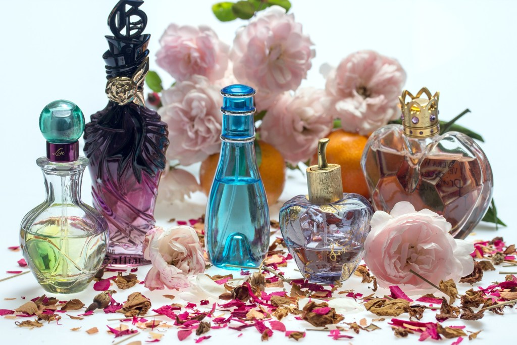 image of perfume bottles and flowers