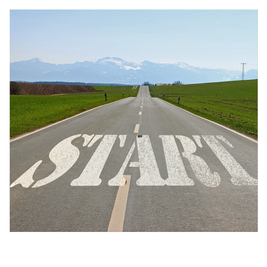 Image of the word Start at the beginning of a road to the mountains, Make your new intentions for the new year.