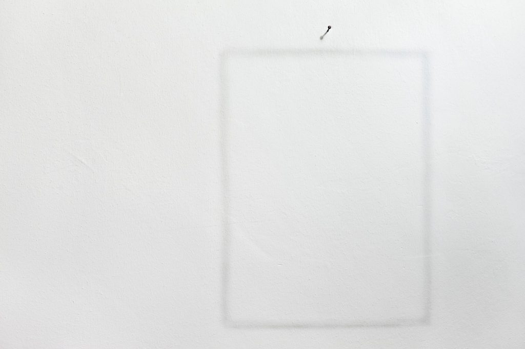 image of a blank pice of canvas pinned to the wall