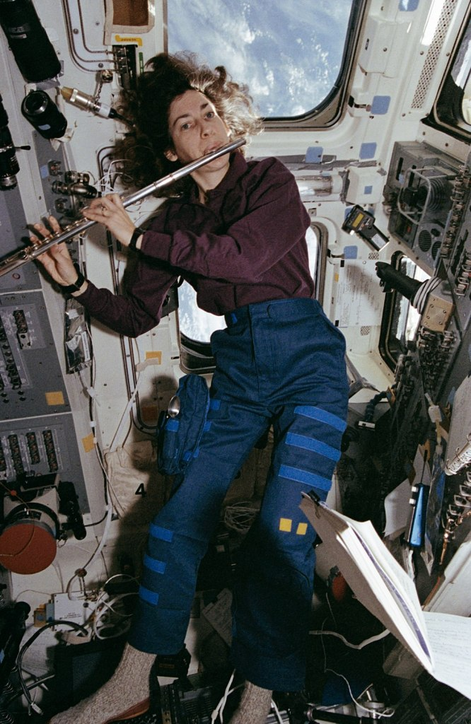 Astronaut Ochoa playing the flute in space