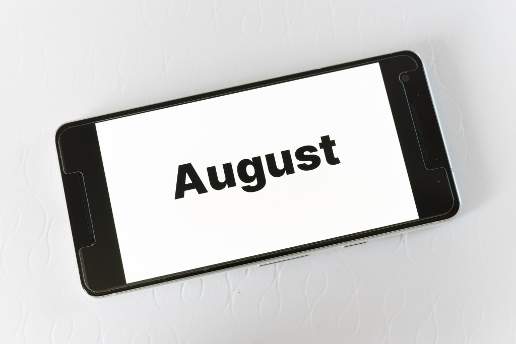 A black cellphone with the word August on a white screen hints of my horrible no good very bad month