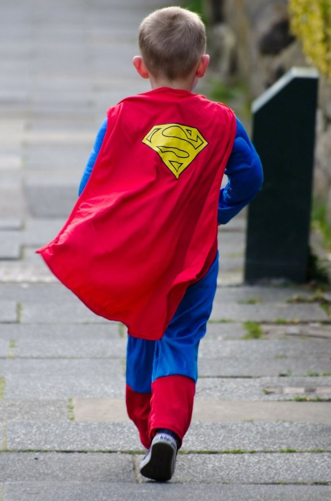 Little boy in a superman costume walking away from the camera--what would you do if your child became a superhero? What if you were a superhero?
