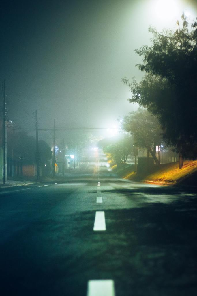 photo down a blacktop road into a small town on a foggy night despite everything that 2020 ha thrown at us we turn on the lights and keep going.