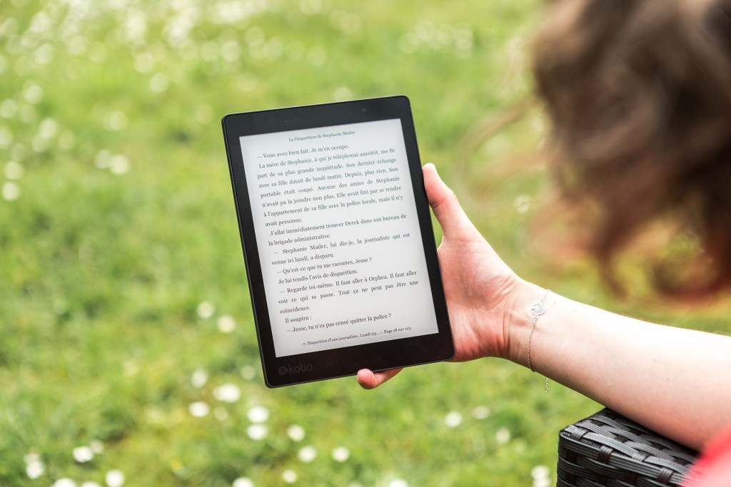 Image of a woman's hand holding an electronic reader--are you a thinking reader?