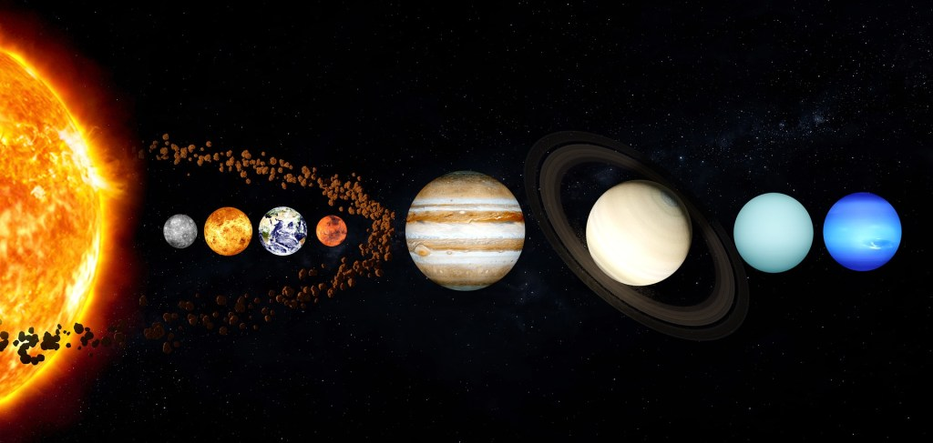 Image of the sun and planets in a row with an illustration of the asteroid belt-is there truth in asteroid dust