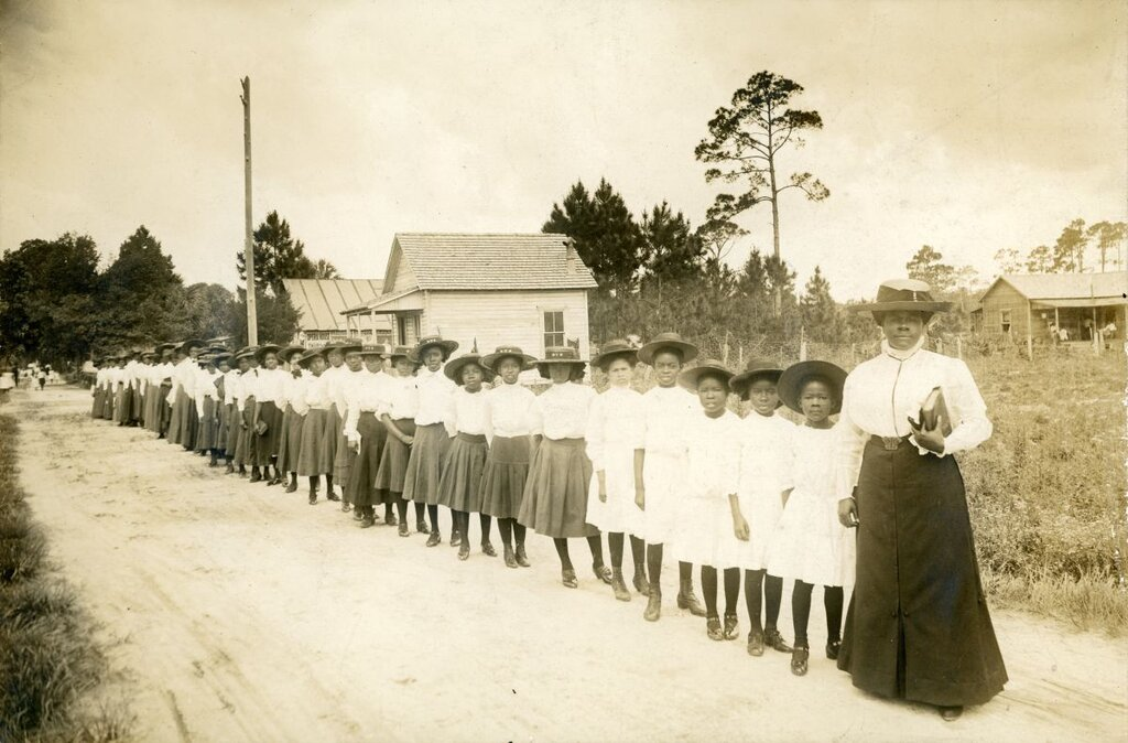 Photograph of Mary McLeod Bethune and a long line of her female students