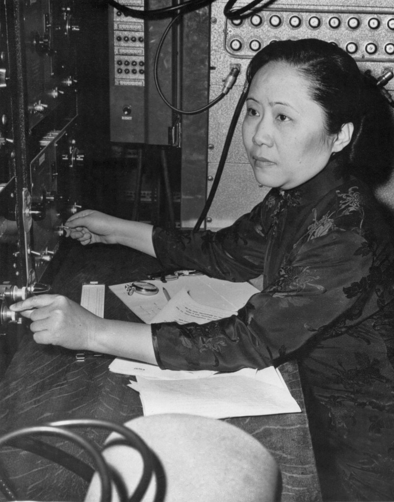 Photograph of Chien-Shiung Wu, the First Lady of Physics, at a bank of equipment