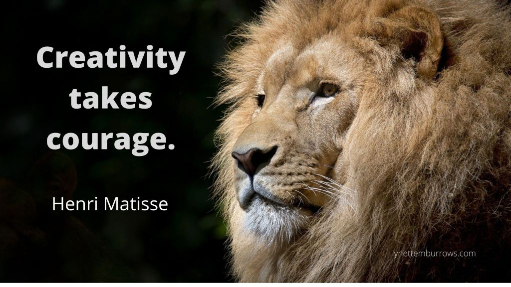 """Image of a lion's face on a black background with the quote """"creativity takes courage by Henri Matisse"""