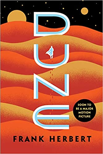 The cover of Dune has alternating orange and yellow sand dunes with two yellow moons visible in a star studded night sky at the top of the page. A lone figure in white strides toward the horizon, his cape fluttering in the wind.