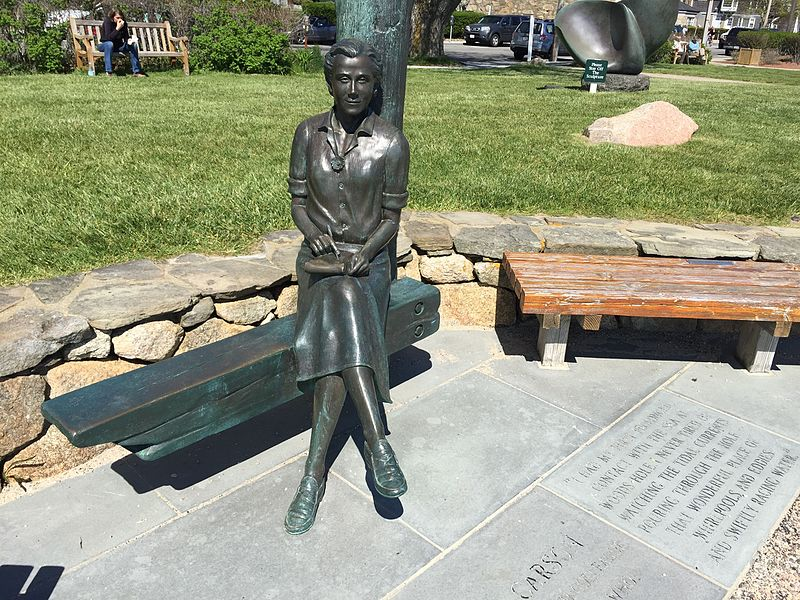 photograph of a bronze sculpture of Rachel Carson sitting on a bench