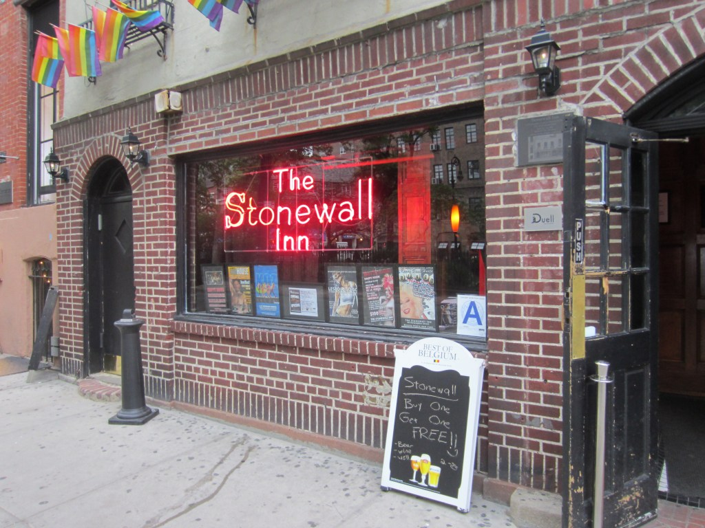 Brick storefront of the Stonewall Inn with the sign in red neon lights.