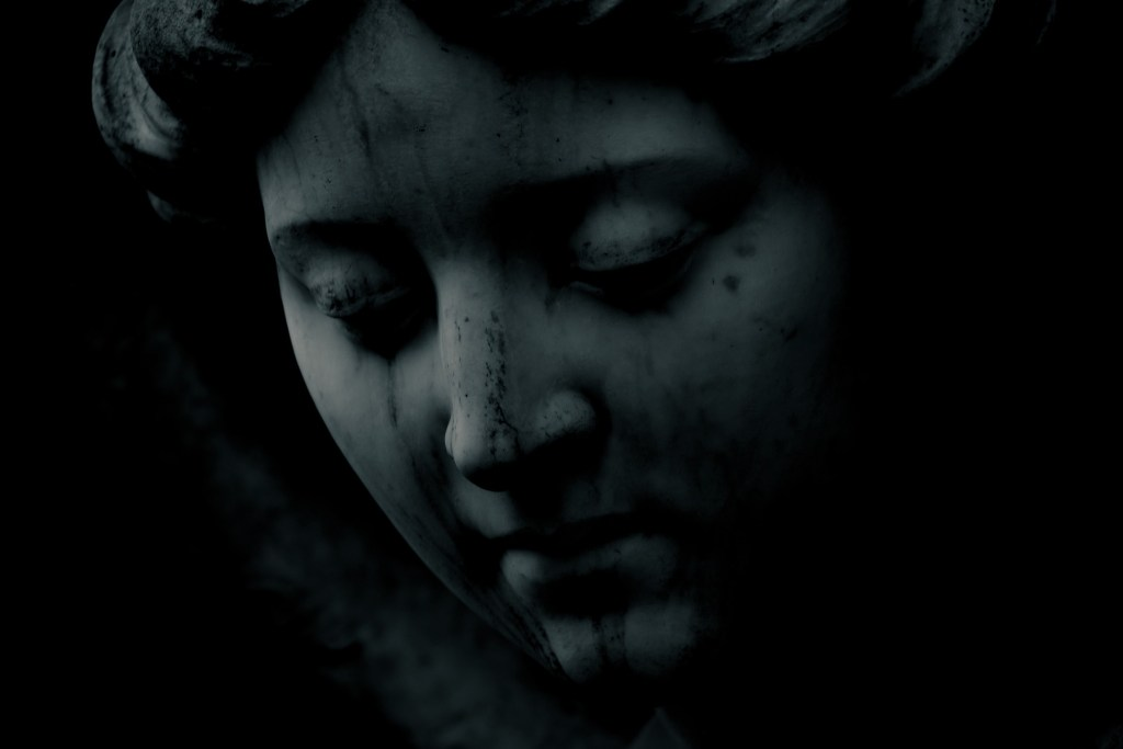 """low light photograph of a bronze statue woman with a """"tear-stained"""" face because the first ninety days of being a widow sucks"""