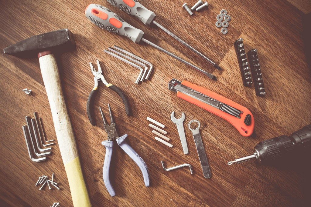 Image of various tools--screw drivers, box cutter, wrenches, pliers, and hammer--always have your crafts tools at hand