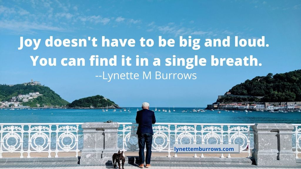 """Photo and quote: you can welcome joy into your life like the older man in this photo. He is looking out across a bay rimmed with mountains, toward the ocean. """"Joy doesn't have to be big and loud. You can find it in a single breath."""" by Lynette M. Burrows"""