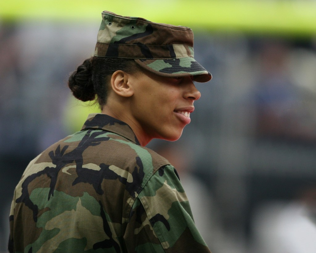 Image of soldier, an African American woman whose stripes are red and white and blue.