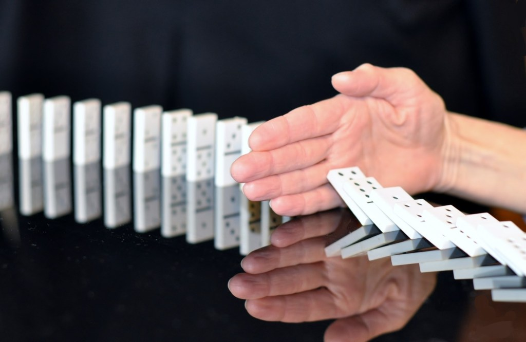 Without sequels your reader won't care and they'll stop reading just like the hand in this photo stops the falling dominoes.