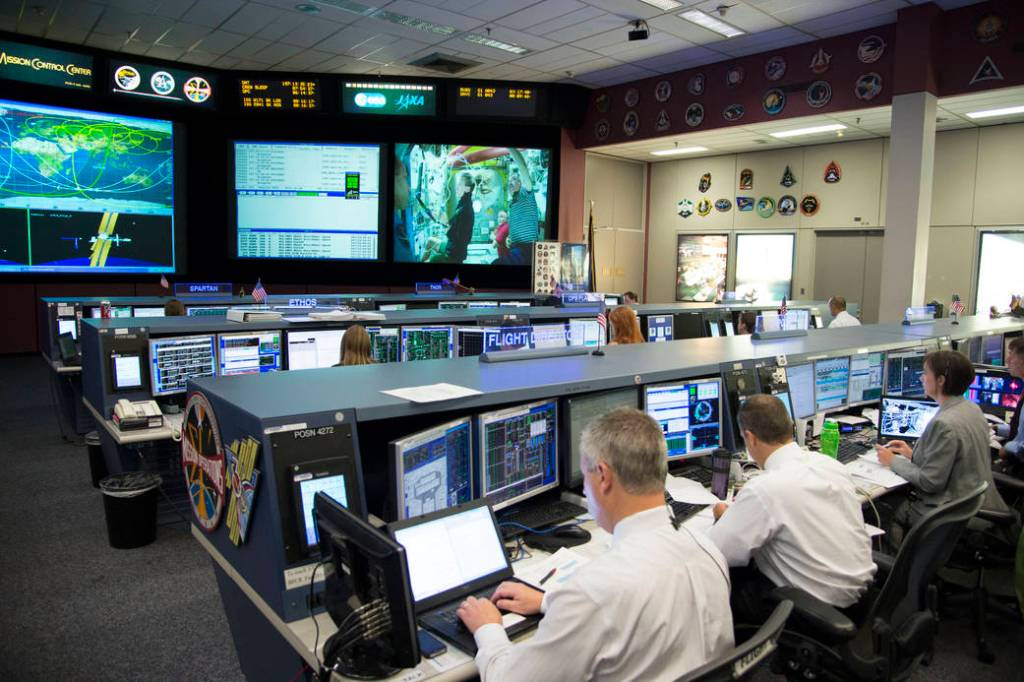 Photograph of the sleek and smaller workstations of NASA's control center in 2013. It looks like a slice of Star Trek life.