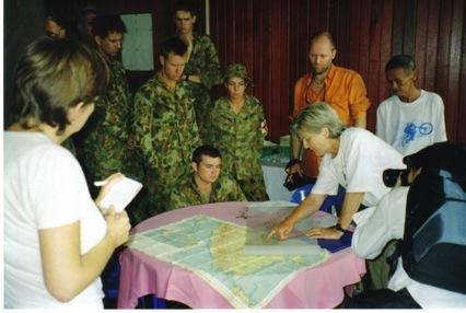 Using the wartime map, Lynette explains the route to members of the Australian Defence Force, during the inaugural trek, March 2006.