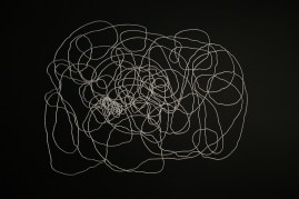 Lyn Horton, White Nylon Cord Installation, 2012, approximately 8 feet h x 9 feet w, white nylon cord and black painted brads on black wall