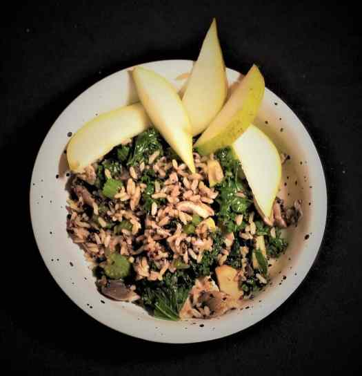 Indigestion Buster: A bowl of quinoa, rice, mushrooms,, spinach decorated with pear slices.