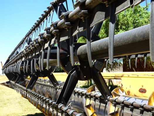 Close up of the front cutter and reel of a combine harvester