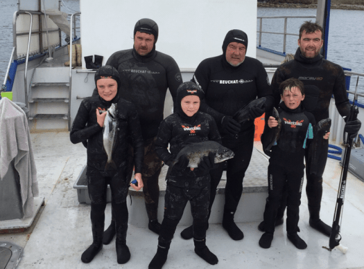 Spearfishing Grandfather, sons and grandsons.