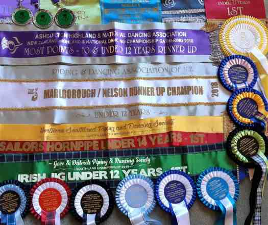 A colourful display of ribbons and rosettes won by Zara in highland dancing competitions.