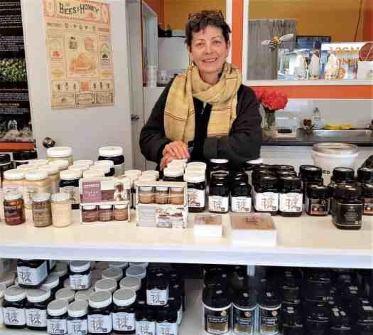 Bene Sparks, always happy to serve up some of her delicious honey in the Garston Hunny Shop.