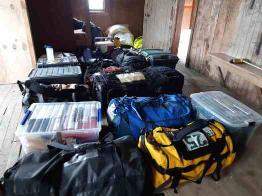 Revenant Competitors' drop bags waiting for their return to HQ, the Ski Hut.