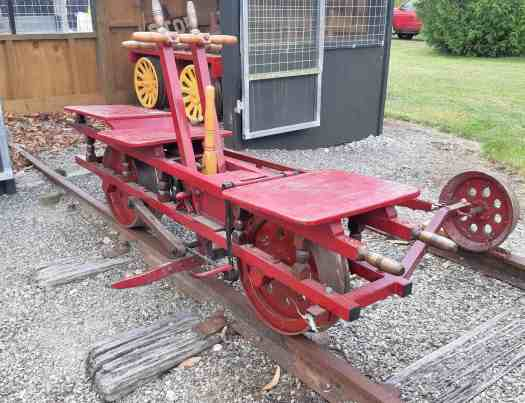 Red and yellow 1910 hand-operated railway jigger restored by Peter Naylor.