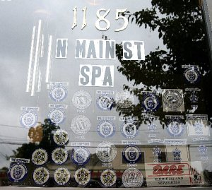 The North Main Street Spa in Providence displays stickers from numerous police groups. Shortly after this photo was taken in July 2009, the stickers were removed. The Providence Journal / Kathy Borchers