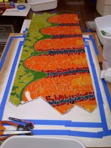 Creating a mosaic art wall mural by Lynn Bridge in Austin, Texas