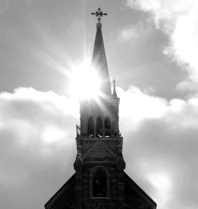 cathedral church spire with lens flare