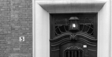 black and white door and lamp in Schleswig Holstein northern Germany