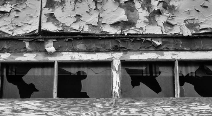 broken glass black and white window