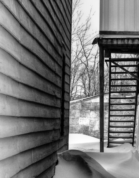 stairs in alley black and white