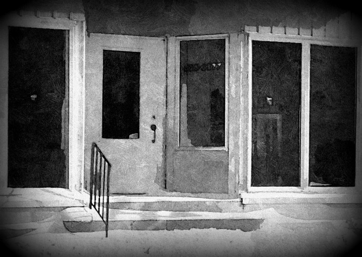 black and white store front door windows