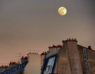 full moon over buildings