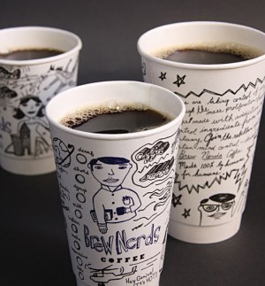 Paper coffee cups with creative writing on them