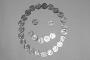 Coins arranged into a smiley face.