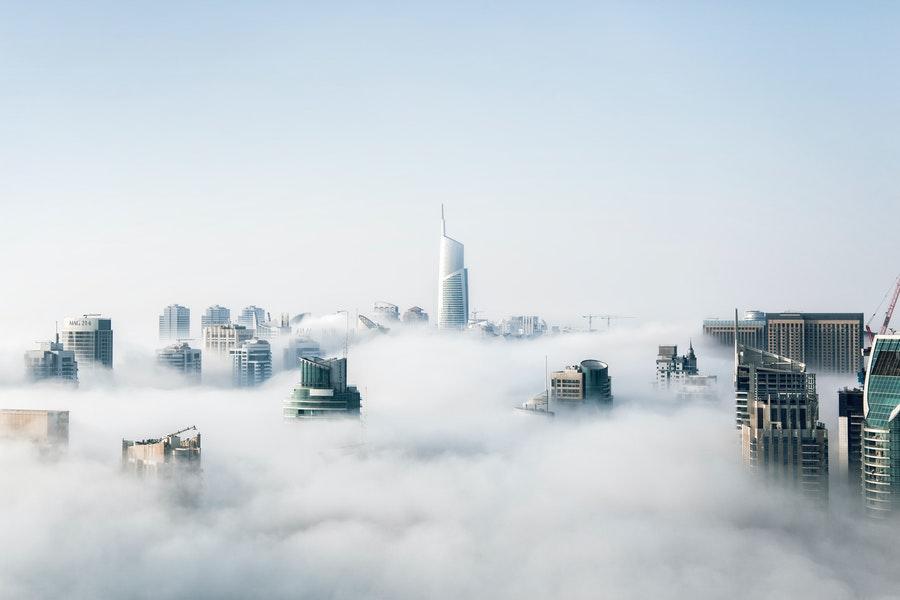 The skyline of a mysterious city shrouded in fog.