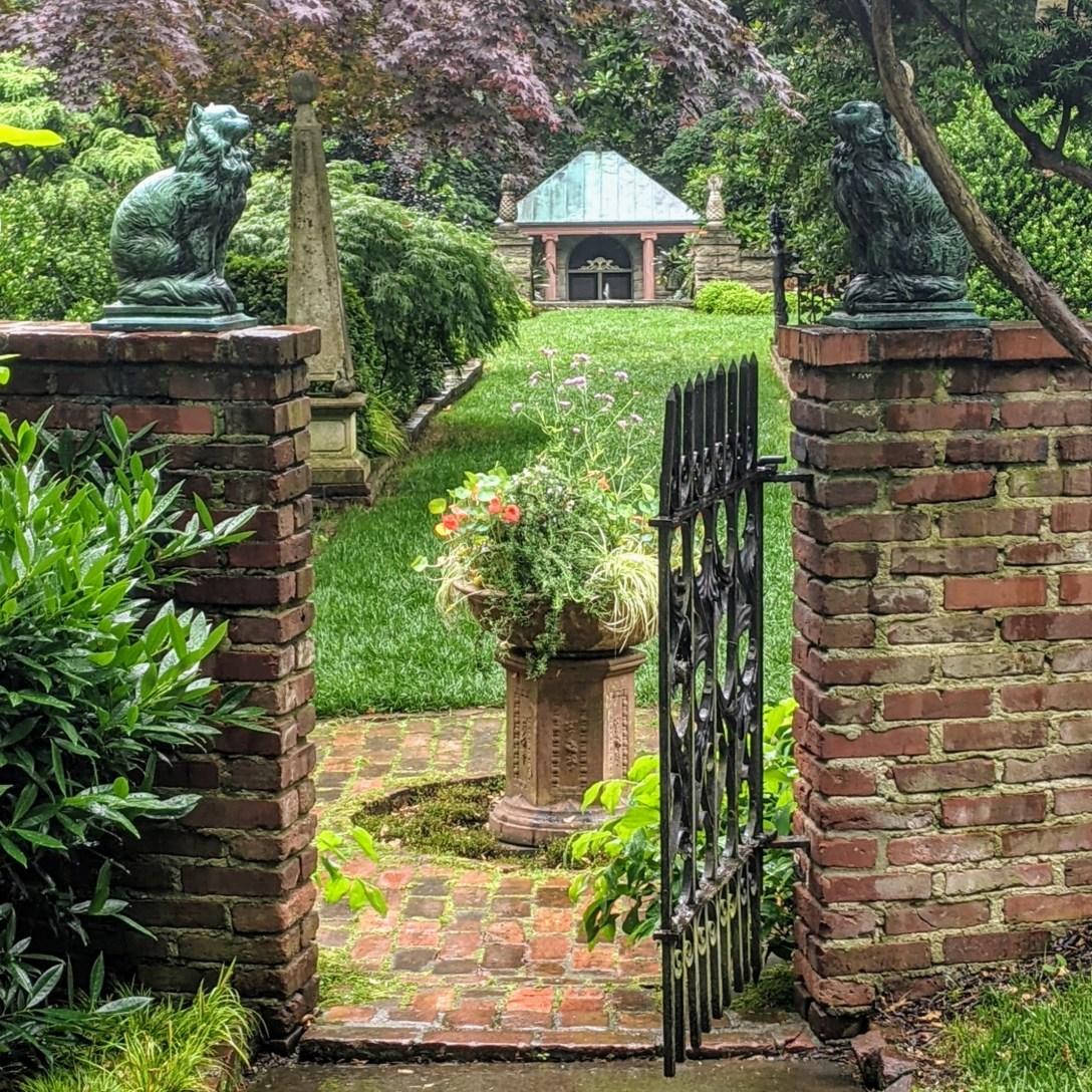 Partially open wrought iron garden gate
