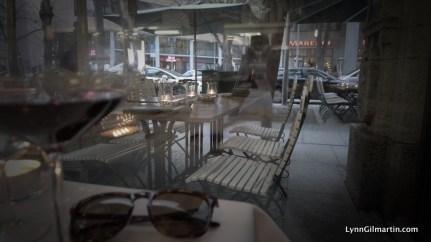 People-watching from inside the cosy Lutter & Wegner restaurant in Potsdamer Platz, Berlin.