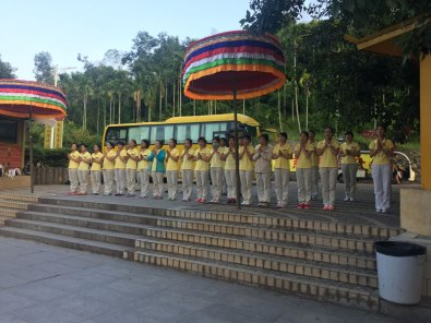 Workers of Nanshan Temple pray together at the end of every day.