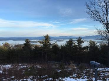 Partially obscured view north from the summit, looking over Lake Winnipesaukee.