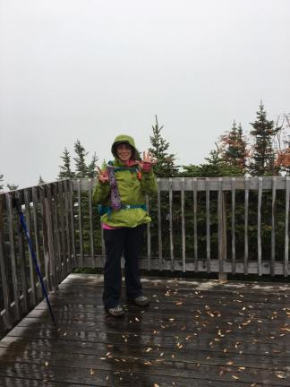 Finally at the summit of Wildcat D, on the observation deck. We observed nothing but clouds, and rain that had begun steadily falling just as we reached the deck. This was my 7th NH 4000 footer.