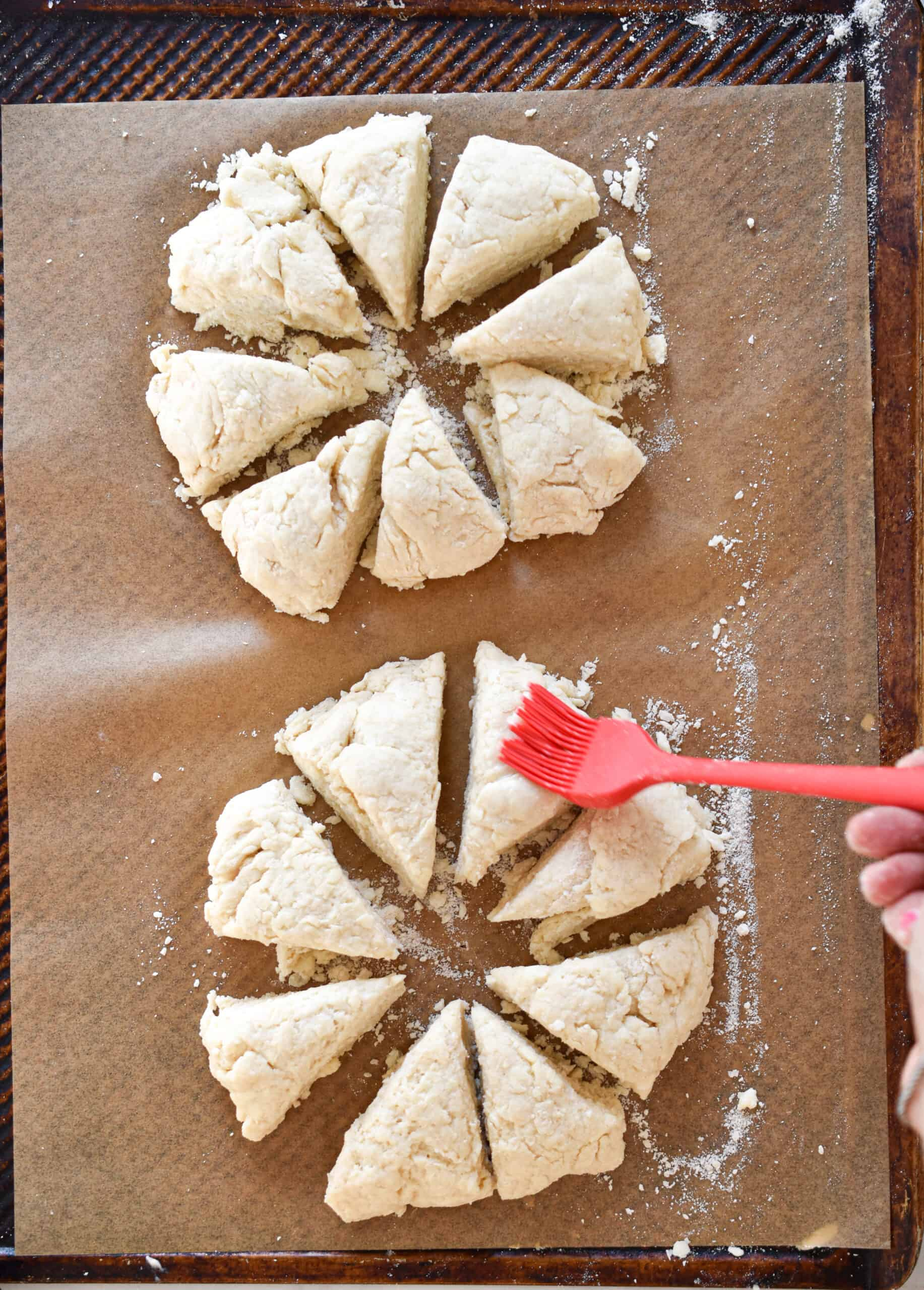 Lightly brush the scones with milk and sprinkle with sugar